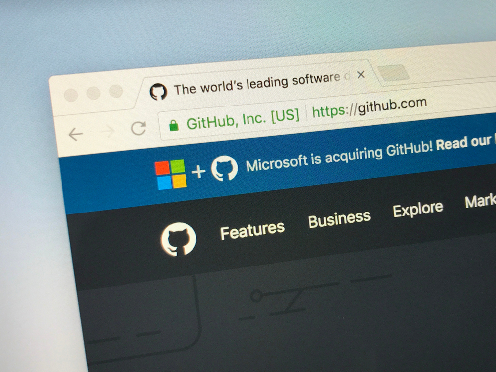 desktop browser showing github in window with Microsoft acquisition banner